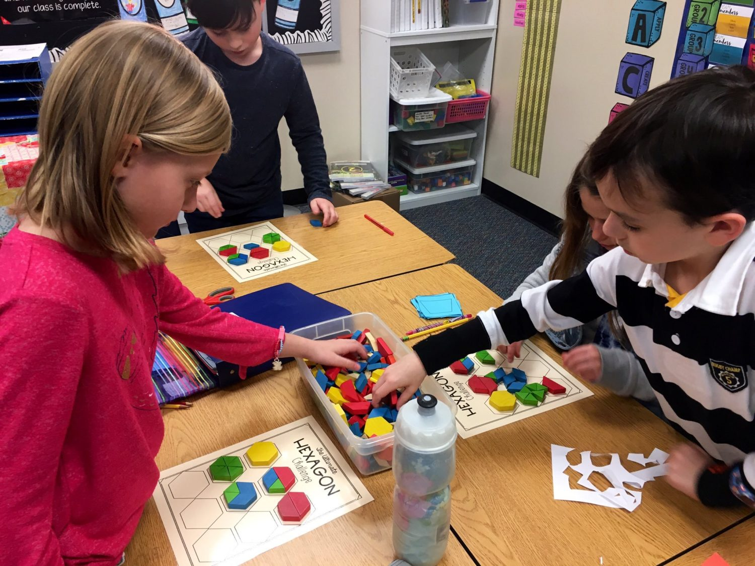 """students build shapes at their desks"""