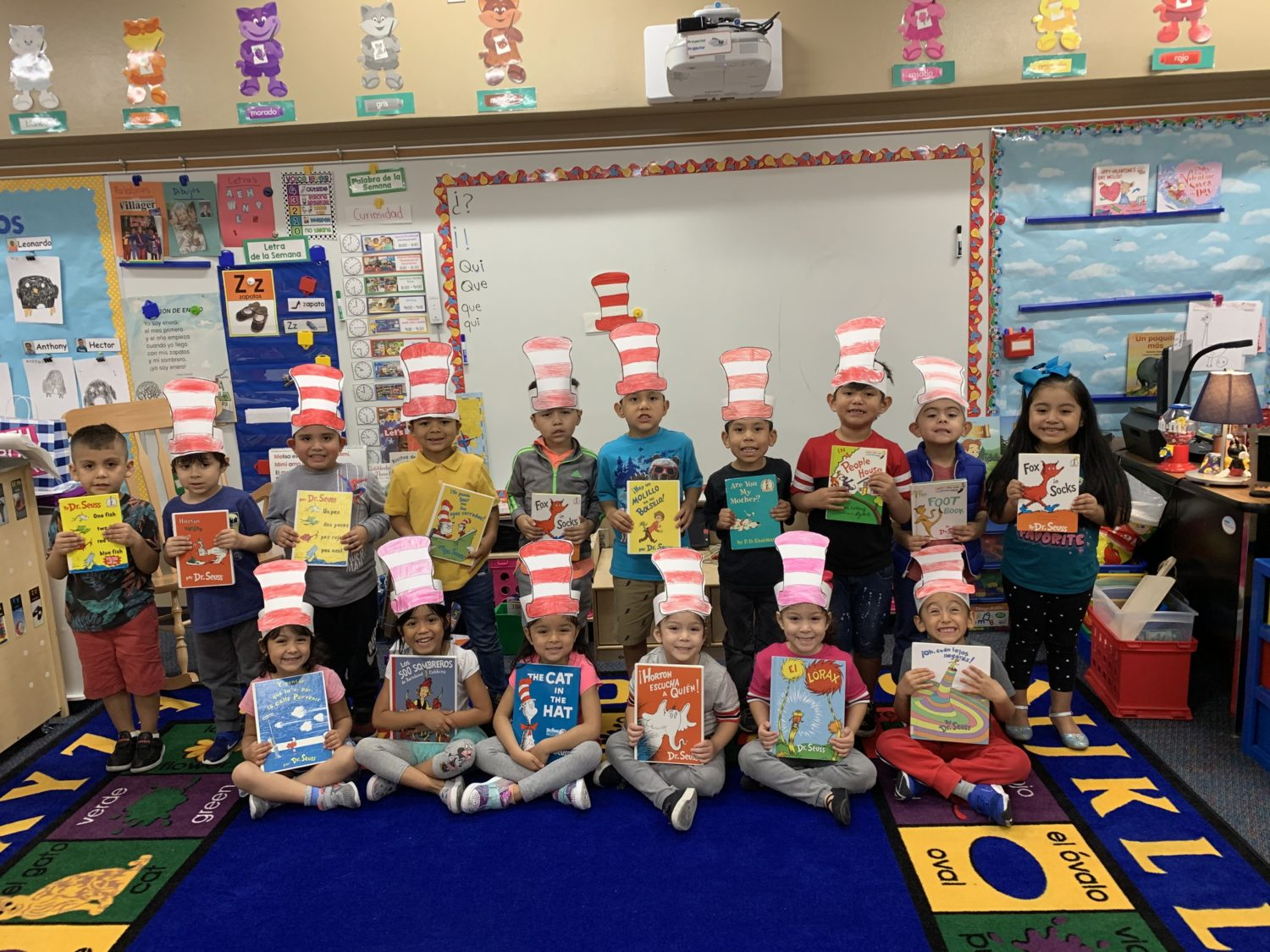 """students hold their favorite Dr. Seuss book"""