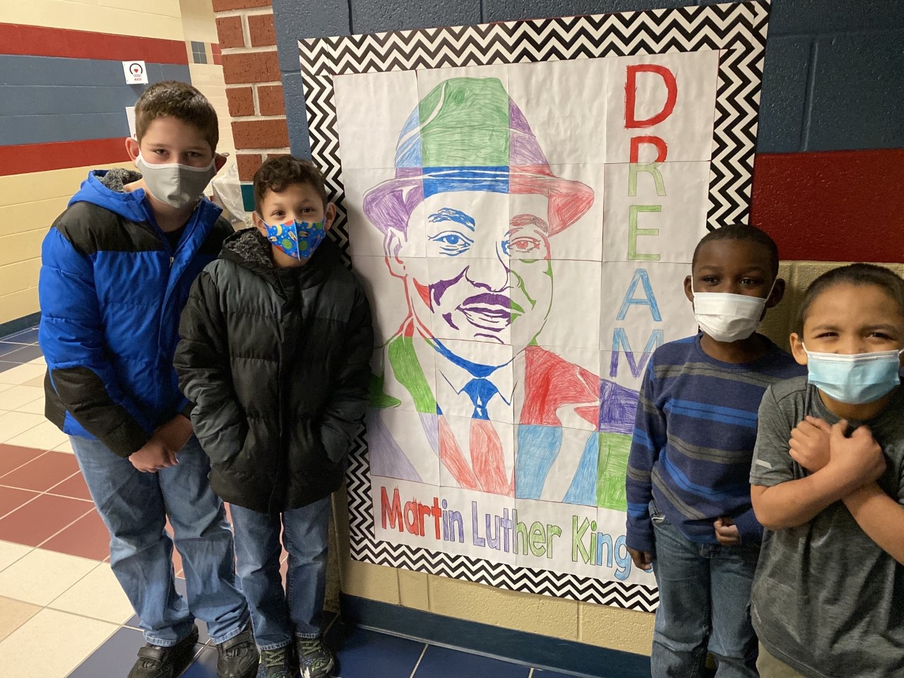 Students stand in front of MLK artwork